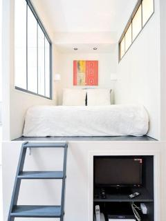 Access to the mezzanine double bed through a fixed wooden stair (4 steps)