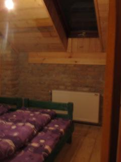 Room with two beds and shared bathroom