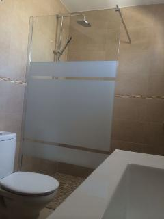 The family shower room is adjacent to the twin and double room