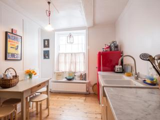 Kitchen with gas hob, oven and grill. Smeg fridge, dishwasher and plenty of crockery etc.  Seats 4-5