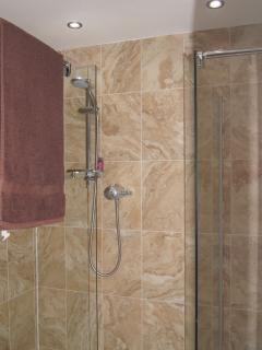 Walk in shower on ground floor with toilet and wash basin. All towels and bath robes provided.