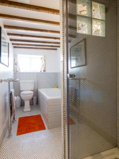 Family bathroom, with underfloor heating, large bath and separate shower.