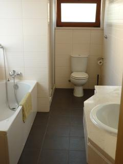 Spacious ensuite bathroom with bath and shower