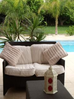 Al fresco seating overlooking  the pool.