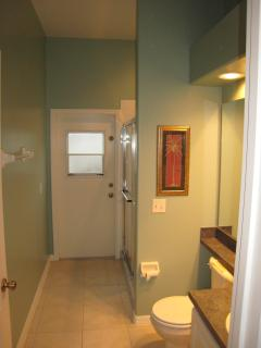 Queen bedroom, private bathroom, pool deck access, full size stand up shower