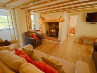 Gadlys cosy sitting room with log fire and oak floor
