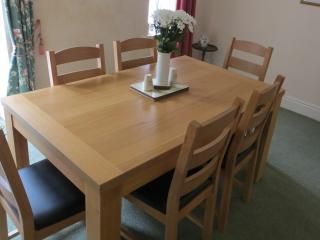 Dining room at Sea Scape Cottage - With patio doors leading onto a furnished sun terrace.