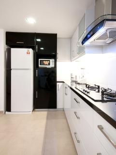 Kitchen with gas stove, fridge freezer, microwave, kettle, toaster, rice cooker, blender