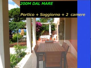 2 bedroom Tuscany holiday apartment rental with lovely garden and porch located just steps from the beach, Procchio