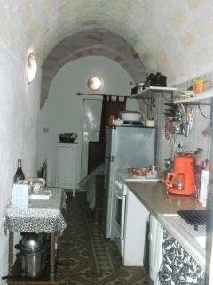 1st arched 'botte' room=furnished kitchen with a 4 burner gas stove/oven, double-sink & fridge