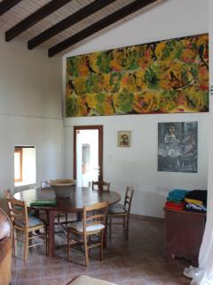 dining area surrounded by original art
