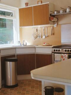 Well equipped light kitchen with 2 fridges and a freezer.