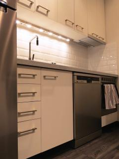 A fully equipped kitchen includes a dishwasher
