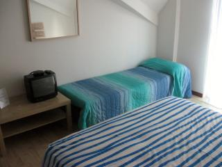 large doble room with 3. beds