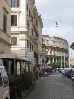 Via S. Giovanni in Laterano with restaurants and cafes and the Colosseum in the back