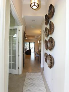 Front Entry Foyer With Antique Bowls Adorning the Wall