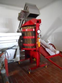 Our winery neighbours have preserved their old-fashioned grape-press for you to see.....
