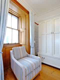 All three bedrooms have original working sash window and shutters