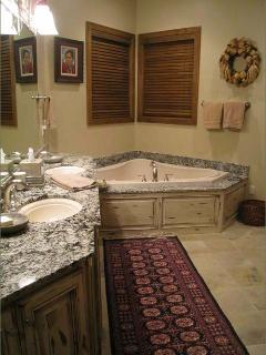 Main Floor Master Bath with Large Tub and Separate Walk In Shower