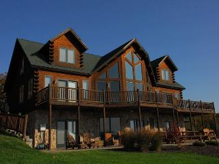 Exquisite 5 Bedroom Luxury Log home offers amazing lake & mountain views!