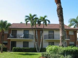 Large first floor 2 bedroom, 2 bath condominium with screen lanai and a short di