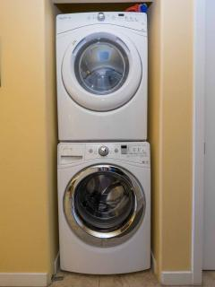 New modern large capacity washer dryer set for our guests' use.