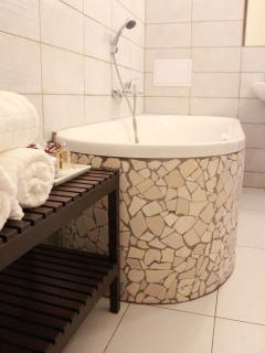 Bathroom with a bath tube