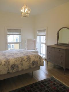 Dresser and closets in bedroom