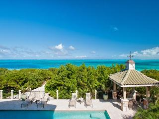 Located on the western end of Grace Bay Beach, this villa is nestled amid cloistered decks. TNC TAM