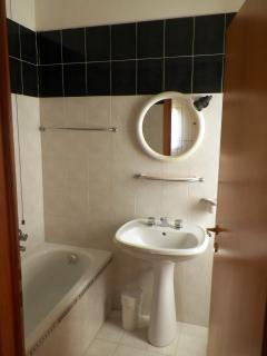 One of 6 bathrooms this one with small bathtub.