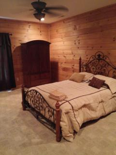 upstairs large bedroom with queen bed