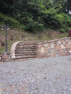 parking area and rock stairway to entry porch