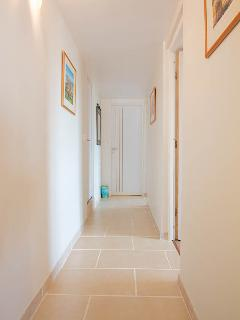Hallway leading to bedrooms and shower room