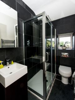 Upstairs shower room and toilet with walk-in shower and heated towel rail