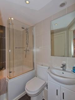 Main bathroom with bath and shower.