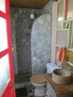 Bathroom with stone-lined shower