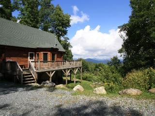 A Mountain Jewel multi-level log home , great view