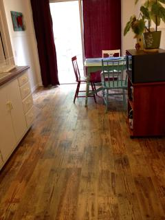 Gorgeous new laminate flooring! This is the kitchen and dining nook