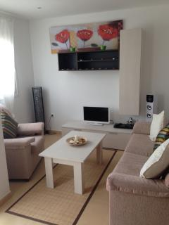 Lounge area with TV,DVD,Bluetooth speaker tower with USB