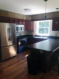 Great kitchen with stainless appliances, all new china, pots pans and glasses