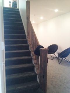 Staircase to lower level into game room