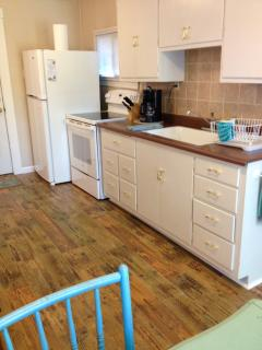 Kitchen includes BRAND NEW range, full size fridge, toaster, coffee maker, blender, electric kettle.