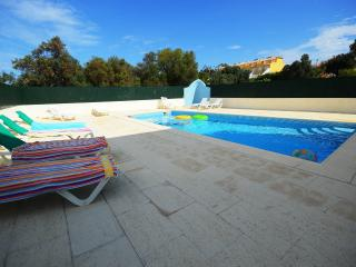 One of 3 available pools . This one is beside the villa and the most relaxing for kids and adults .