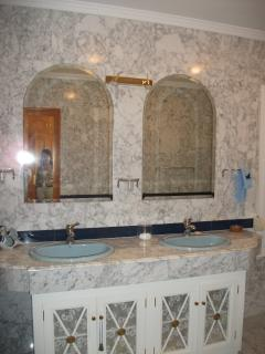 large en-suite bathroom with his and hers wash basins