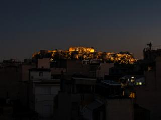 Trendy penthouse with private balcony and views of the Acropolis. Sleeps 4.