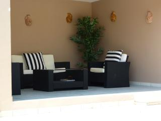 Shaded pool-side seating area