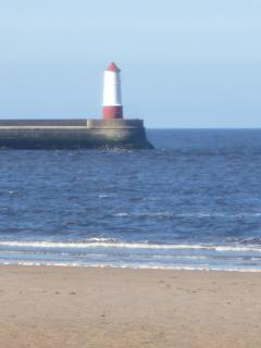 Spittal lighthouse looking from the clean sandy beach near Mill Wharf