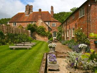 Coach House on right with private walled garden with chaise longue
