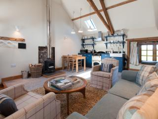 The interior of the barn is welcoming and cosy with many stunning original features