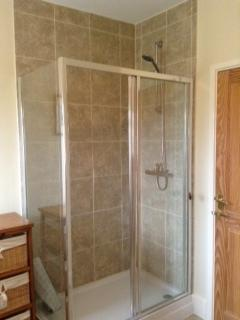Extra-large walk in shower cubicle in Sewin's family bathroom
